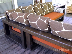 Rear view of the outdoor sectional couch, finished in a brazilnut stain.<br />