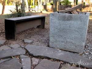 The flat-top plankBench next to our cast-concrete firepit.