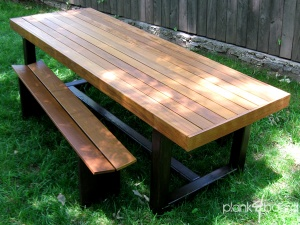 This outdoor dining table is 8 feet long and 3 feet wide and can be created in a variety of Brazilian hardwoods.<br />