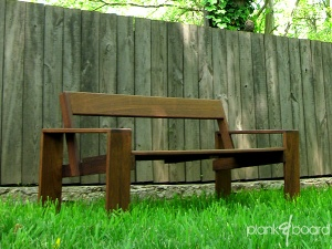A clean, simple take on the classic outdoor bench with a back.