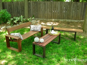An outdoor seating area featuring the simpleBench, the slatBench (as a coffee table) and a slantBench.